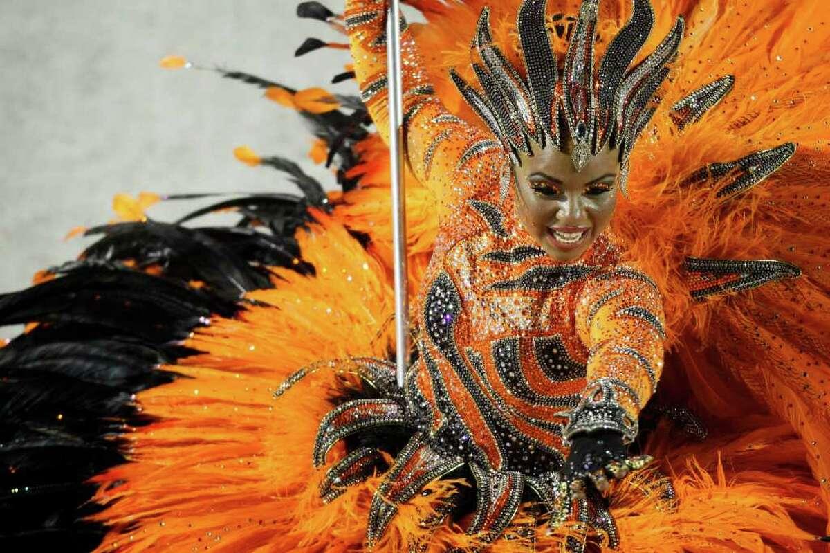 A dancer of Porto da Pedra samba school parades during carnival celebrations at the Sambadrome in Rio de Janeiro, Brazil, Monday Feb. 20, 2012. Millions watched the sequin-clad samba dancers at Rio de Janeiro's iconic Carnival parade. (AP Photo/Felipe Dana)