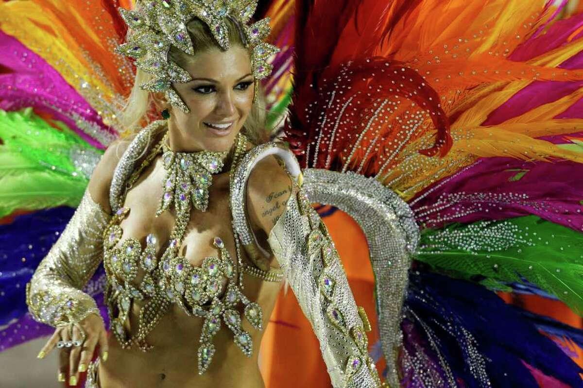 A dancer from Mocidade samba school parades during carnival celebrations at the Sambadrome in Rio de Janeiro, Brazil, Monday Feb. 20, 2012. (AP Photo/Felipe Dana)