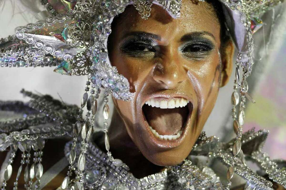 A dancer from the Mocidade samba school parades on a float during carnival celebrations at the Sambadrome in Rio de Janeiro, Brazil, Monday Feb. 20, 2012. (AP Photo/Felipe Dana)