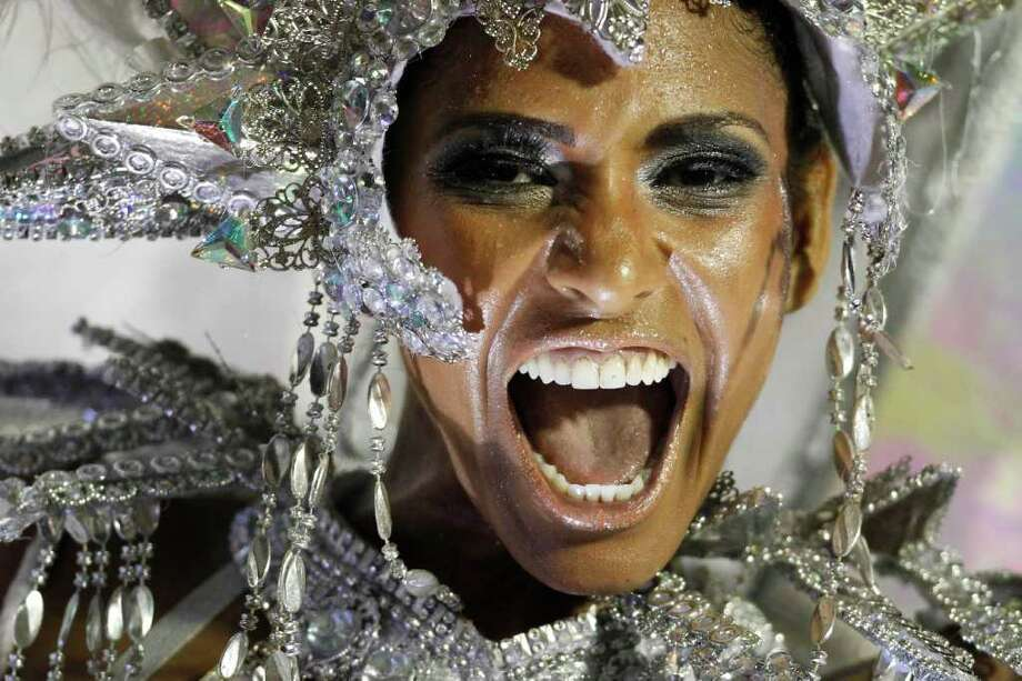 A dancer from the Mocidade samba school parades on a float during carnival celebrations at the Sambadrome in Rio de Janeiro, Brazil, Monday Feb. 20, 2012. (AP Photo/Felipe Dana) Photo: Felipe Dana, ASSOCIATED PRESS / Associated Press
