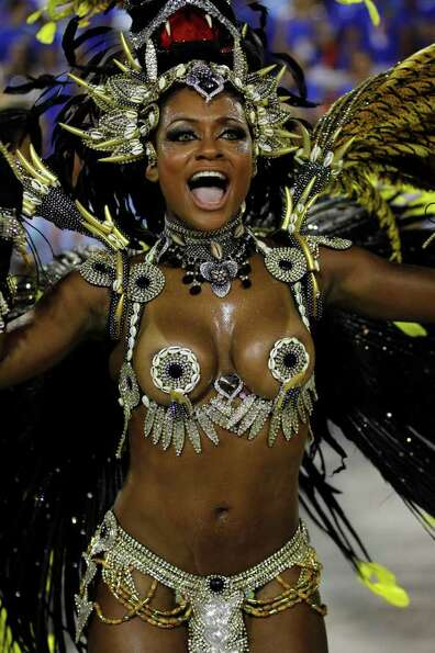 A performer from the Beija Flor samba school parades during carnival celebrations at the Sambadrome