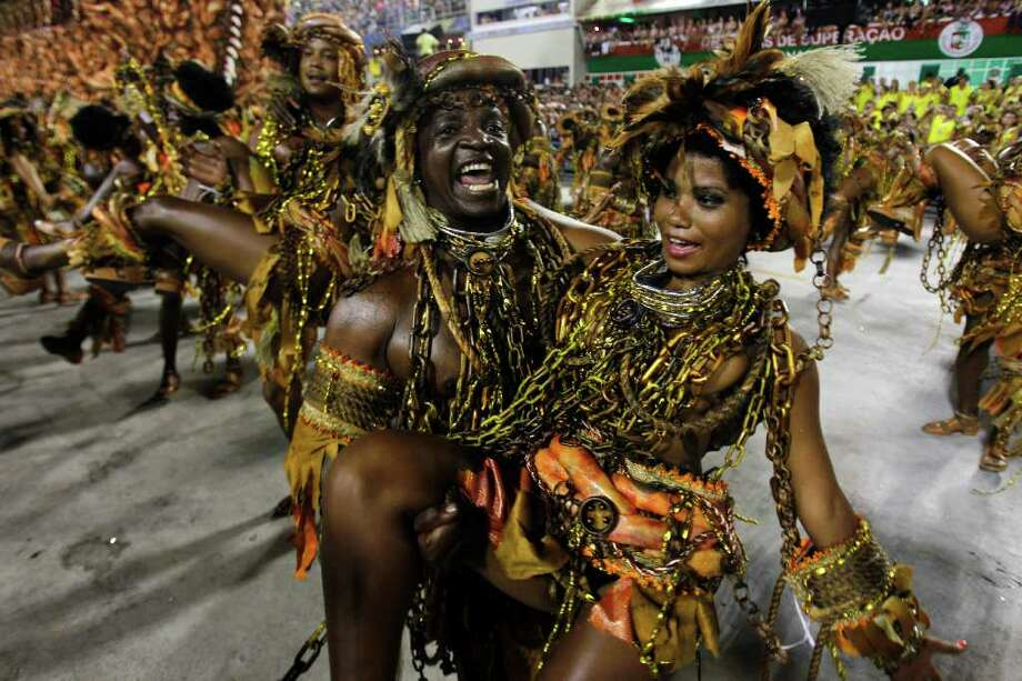 Performers from the Beija Flor samba school parade during carnival celebrations at the Sambadrome in Rio de Janeiro, Brazil, Monday, Feb. 20, 2012. Millions watched the sequin-clad samba dancers at Rio de Janeiro's iconic Carnival parade.  (AP Photo/Victor R. Caivano) Photo: Victor R. Caivano, ASSOCIATED PRESS / Associated Press