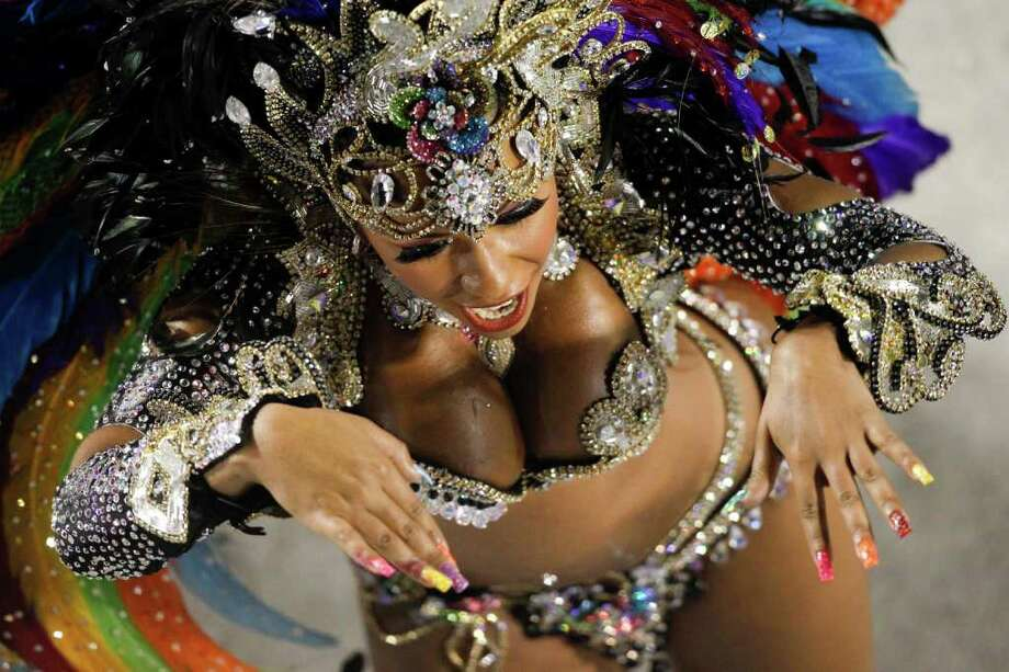 A dancer of Beija Flor samba school parades during carnival celebrations at the Sambadrome in Rio de Janeiro, Brazil, Monday Feb.  20, 2012. (AP Photo/Felipe Dana) Photo: Felipe Dana, ASSOCIATED PRESS / Associated Press