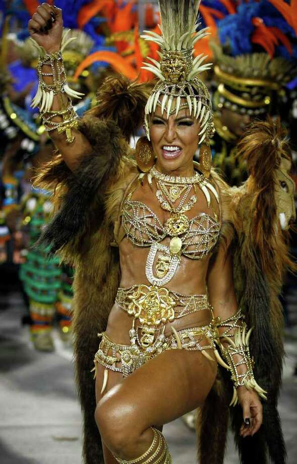 Sabrina Sato, Queen of Vila Isabel samba school, parades at the Sambadrome during carnival celebrations in Rio de Janeiro, Brazil, Monday, Feb. 20, 2012.  Millions watched the sequin-clad samba dancers at Rio de Janeiro's iconic Carnival parade.   (AP Photo/Victor R. Caivano) Photo: Victor R. Caivano, ASSOCIATED PRESS / Associated Press