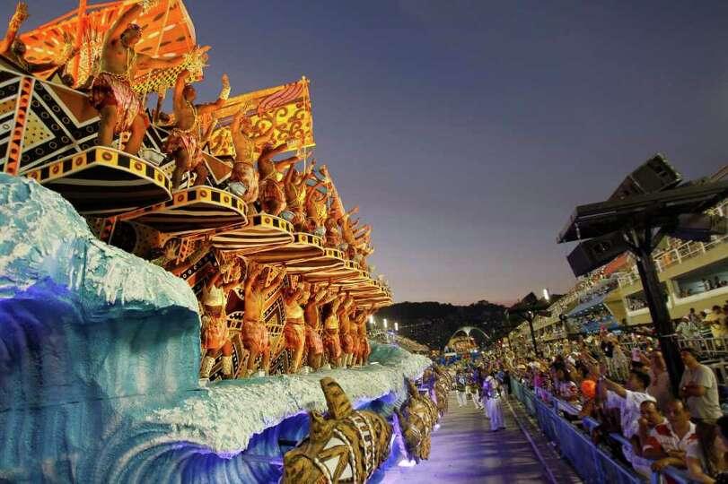Performers from the Unidos da Vila Isabel samba school parade during carnival celebrations at the Sa