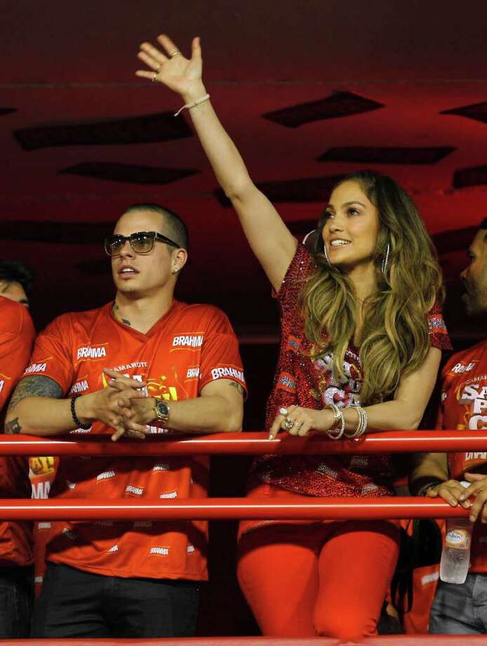 Jennifer Lopez waves to people as she watches carnival parades with Casper Smart at the Sambadrome in Rio de Janeiro, Brazil, Sunday Feb. 19, 2012. (AP Photo/Victor R. Caivano) Photo: Victor R. Caivano, ASSOCIATED PRESS / Associated Press