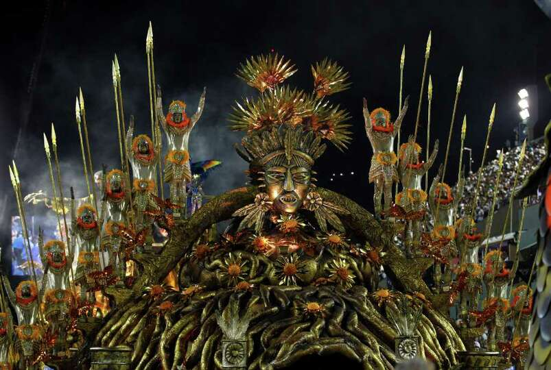 Performers from the Beija Flor samba school parade during carnival celebrations at the Sambadrome in