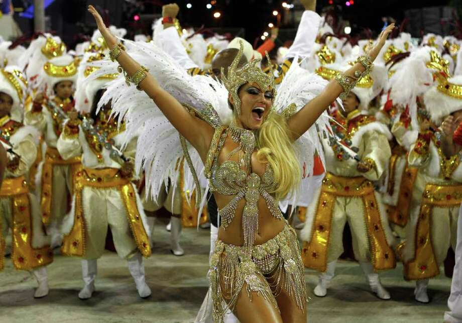 Performers from the Beija Flor samba school parade during carnival celebrations at the Sambadrome in Rio de Janeiro, Brazil, Monday, Feb. 20, 2012. Millions watched the sequin-clad samba dancers at Rio de Janeiro's iconic Carnival parade.(AP Photo/Victor R. Caivano) Photo: Victor R. Caivano, ASSOCIATED PRESS / Associated Press