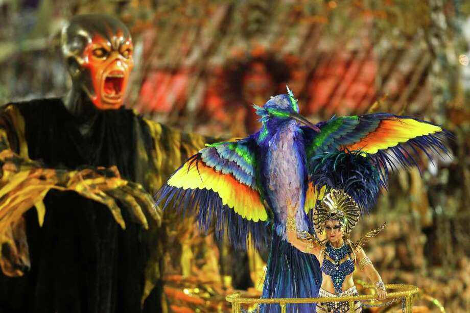 A dancer of Beija Flor samba school parades on a float during carnival celebrations at the Sambadrome in Rio de Janeiro, Brazil, Monday Feb.  20, 2012. (AP Photo/Felipe Dana) Photo: Felipe Dana, ASSOCIATED PRESS / Associated Press