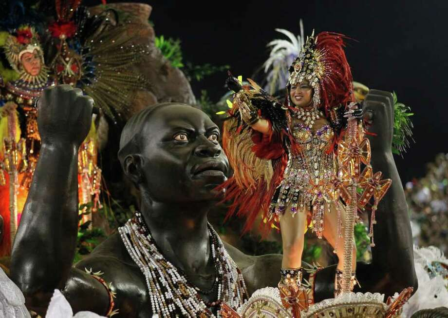 Performers from the Beija Flor samba school parade during carnival celebrations at the Sambadrome in Rio de Janeiro, Brazil, Monday, Feb. 20, 2012. Millions watched the sequin-clad samba dancers at Rio de Janeiro's iconic Carnival parade.  (AP Photo/Silvia Izquierdo) Photo: Silvia Izquierdo, ASSOCIATED PRESS / Associated Press