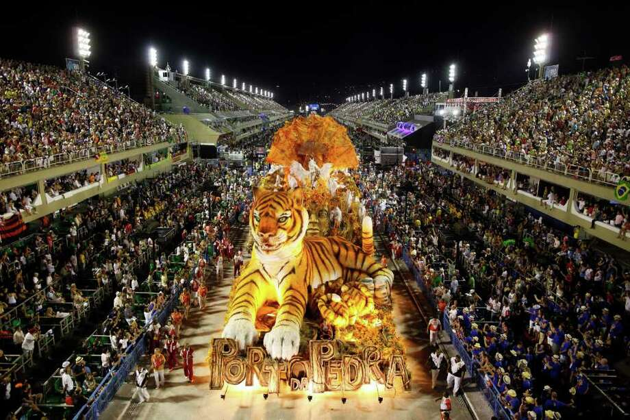 Dancers of Porto da Pedra samba school parade on a float during carnival celebrations at the Sambadrome in Rio de Janeiro, Brazil, Monday Feb.  20, 2012. (AP Photo/Felipe Dana) Photo: Felipe Dana, ASSOCIATED PRESS / Associated Press