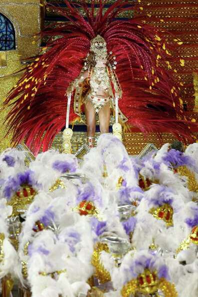 A dancer of Porto da Pedra samba school parades during carnival celebrations at the Sambadrome in Ri