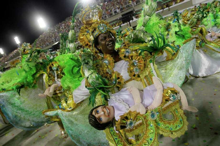 Performers from the Mocidade Independente de Padre Miguel samba school parade during carnival celebrations at the Sambadrome in Rio de Janeiro, Brazil, Monday, Feb. 20, 2012. Millions watched the sequin-clad samba dancers at Rio de Janeiro's iconic Carnival parade.  (AP Photo/Silvia Izquierdo) Photo: Silvia Izquierdo, ASSOCIATED PRESS / Associated Press