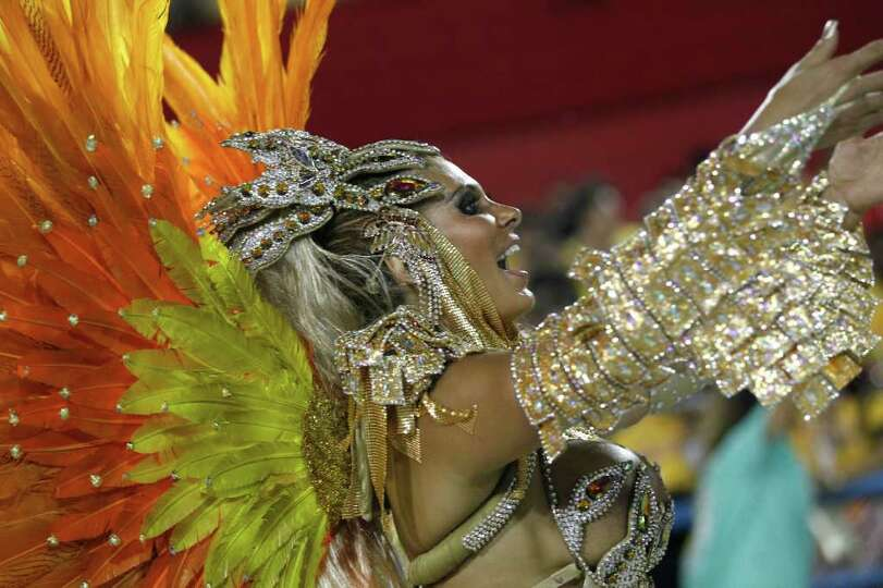 Performer from the Mocidade Independente de Padre Miguel samba school parades during carnival celebr