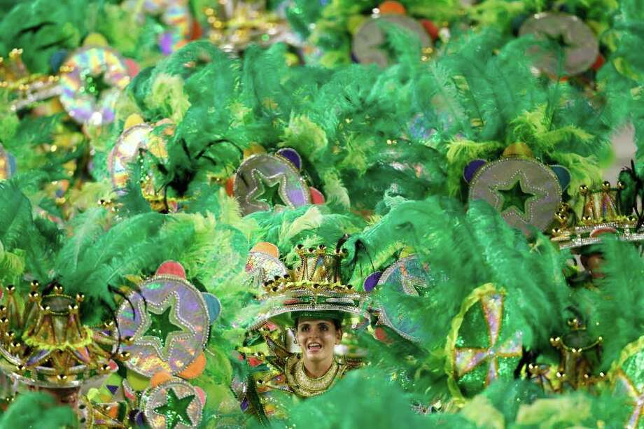 Dancers of Mocidade samba school parade during carnival celebrations at the Sambadrome in Rio de Janeiro, Brazil, Monday Feb.  20, 2012. (AP Photo/Felipe Dana) Photo: Felipe Dana, ASSOCIATED PRESS / Associated Press