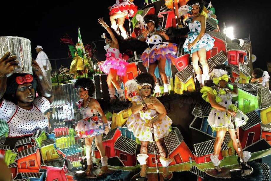 Dancers from the Mocidade samba school parade on a float during carnival celebrations at the Sambadrome in Rio de Janeiro, Brazil, Monday Feb. 20, 2012. (AP Photo/Felipe Dana) Photo: Felipe Dana, ASSOCIATED PRESS / Associated Press