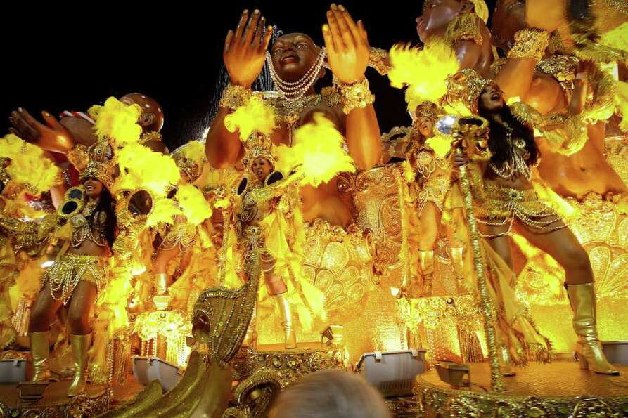 Dancers from the Imperatriz samba school perform on a float during carnival celebrations at the Samb