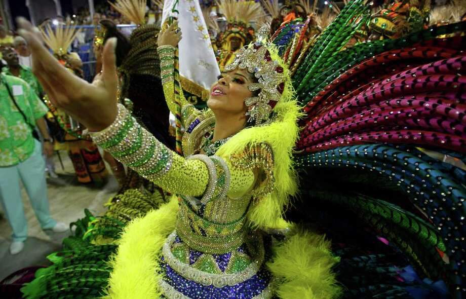 A dancer from the Imperatriz samba school sings during carnival celebrations at the Sambadrome in Rio de Janeiro, Brazil, Sunday, Feb. 19, 2012. (AP Photo/Victor R. Caivano) Photo: Victor R. Caivano, ASSOCIATED PRESS / Associated Press