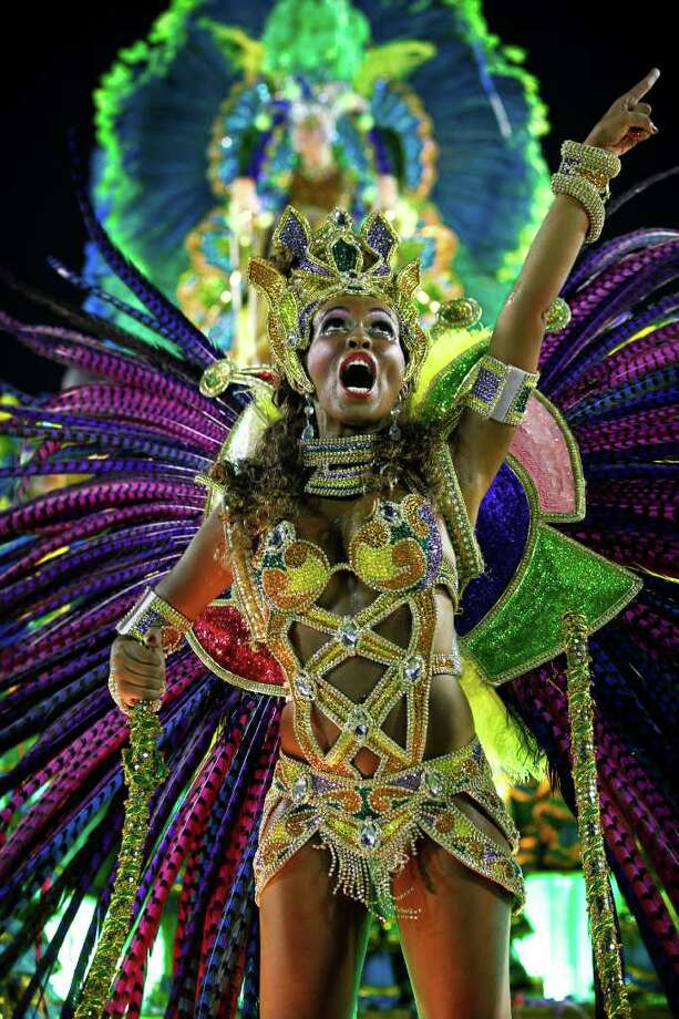 A dancer from the Imperatriz samba school sings on a float during carnival celebrations at the Sambadrome in Rio de Janeiro, Brazil, Sunday Feb. 19, 2012. (AP Photo/Victor R. Caivano) Photo: Victor R. Caivano, ASSOCIATED PRESS / Associated Press