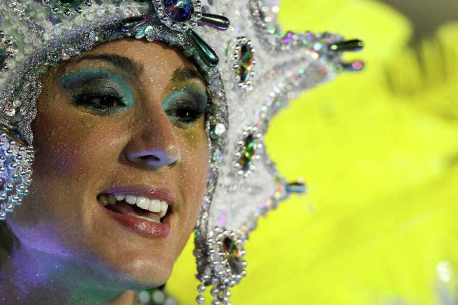 A dancer from the Imperatriz Leopoldinense samba school parades on a float during carnival celebrati