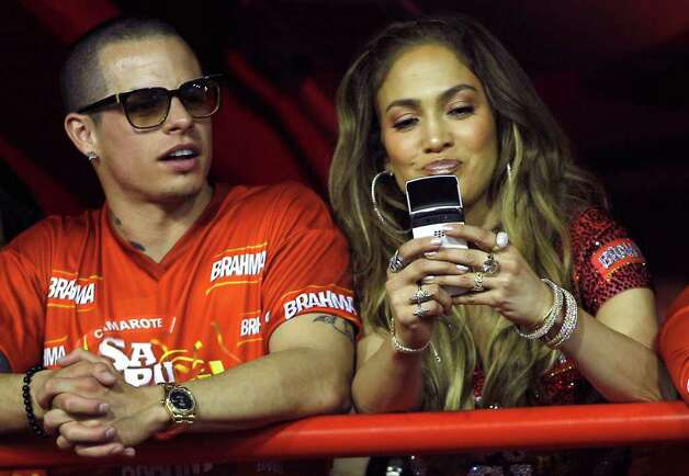 Jennifer Lopez, right, and Casper Smart watch carnival parades at the Sambadrome in Rio de Janeiro, Brazil, Sunday Feb. 19, 2012. (AP Photo/Victor R. Caivano) Photo: Victor R. Caivano, ASSOCIATED PRESS / Associated Press