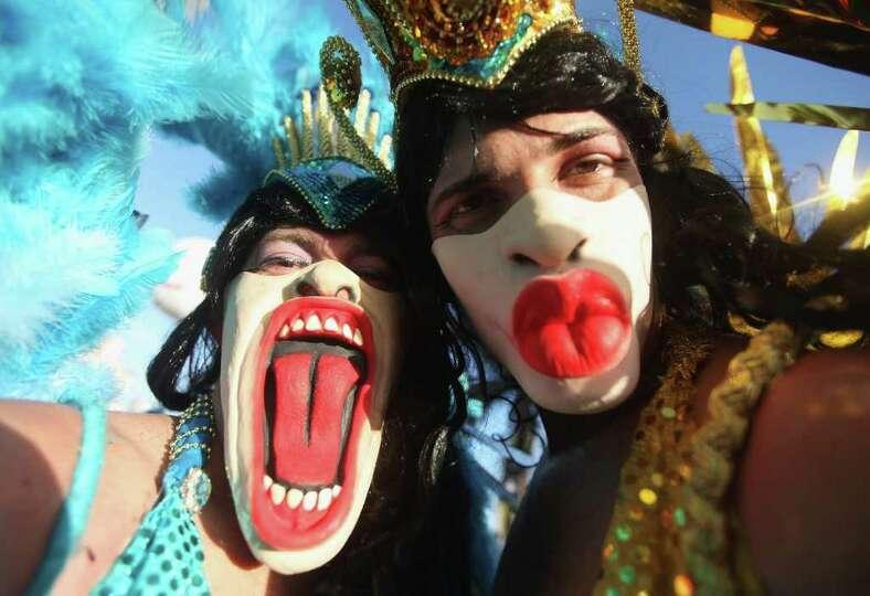 RIO DE JANEIRO, BRAZIL - FEBRUARY 18: Brazilian revelers pose during Carnival celebrations along Ipa