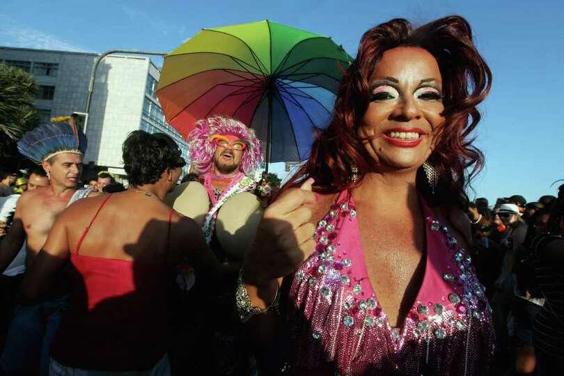 RIO DE JANEIRO, BRAZIL - FEBRUARY 18: Brazilian revelers walk during Carnival celebrations along Ipa