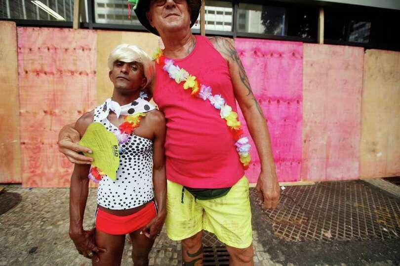 RIO DE JANEIRO, BRAZIL - FEBRUARY 19:  A couple poses during Carnival celebrations on February 19, 2