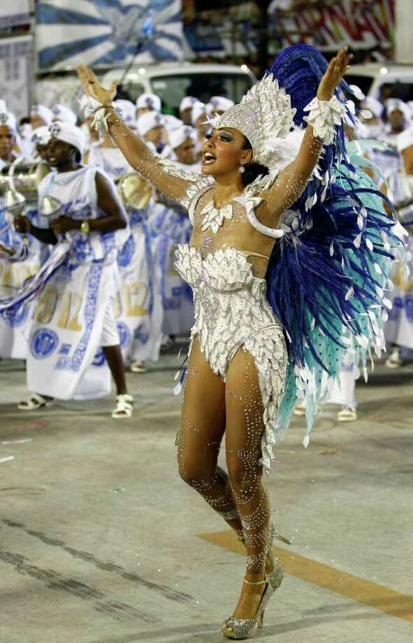 Drum queen Sheron Menezzes from the Portela samba school dances during a carnival parade at the Sambadrome in Rio de Janeiro, Brazil, Sunday Feb. 19, 2012. (AP Photo/Victor R. Caivano) Photo: Victor R. Caivano, ASSOCIATED PRESS / Associated Press