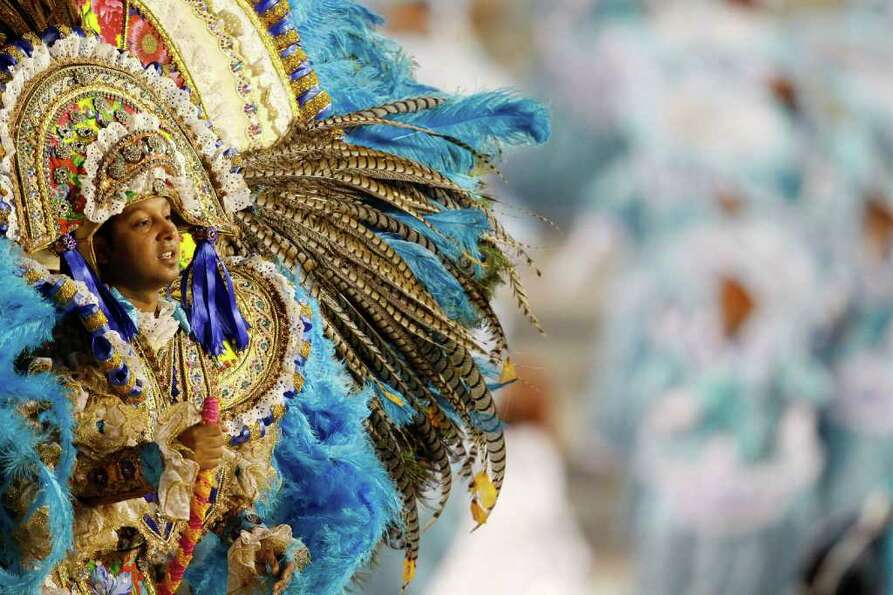 A dancer from the Portela samba school performs on a float during a carnival parade at the Sambadrom