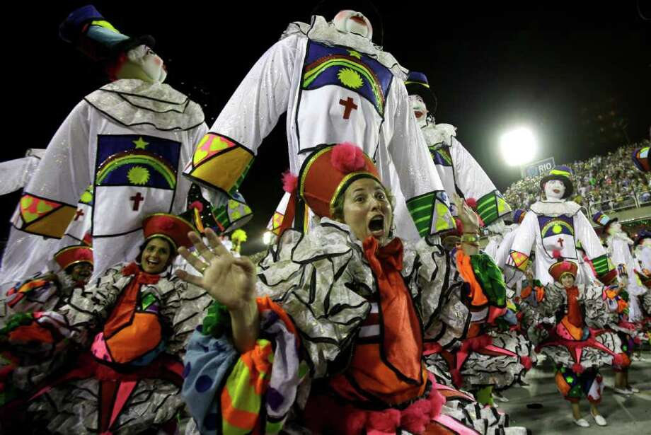 Performers from the Renascer de Jacarepagua samba school parade during carnival celebrations at the Sambadrome in Rio de Janeiro, Brazil, Sunday Feb. 19, 2012. (AP Photo/Victor R. Caivano) Photo: Victor R. Caivano, ASSOCIATED PRESS / Associated Press