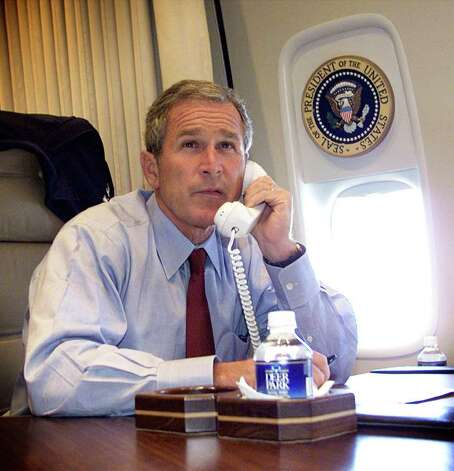 President George W. Bush talks on the phone with New York Mayor Rudy Guiliani and Gov. George Pataki aboard Air Force One on September 11, 2001. Photo: DOUG MILLS, AFP/Getty Images / AFP