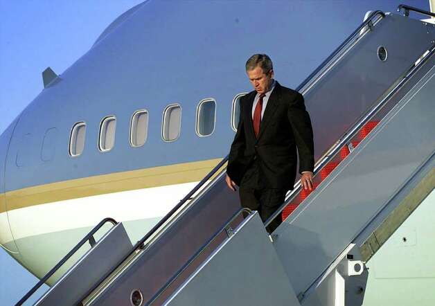 President George W. Bush walks down the steps of Air Force One as he arrives at Andrews Air Force Base, in Maryland, on September 11, 2001. Photo: DOUG MILLS, AFP/Getty Images / AFP