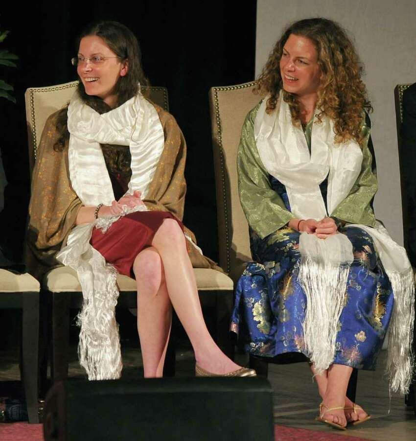 Clare Bronfman, left, and Sara Bronfman, right, during an appearance by the Dalai Lama at the Palace Theatre in Albany, N.Y., Wed., May 6, 2009. (Philip Kamrass / Times Union)