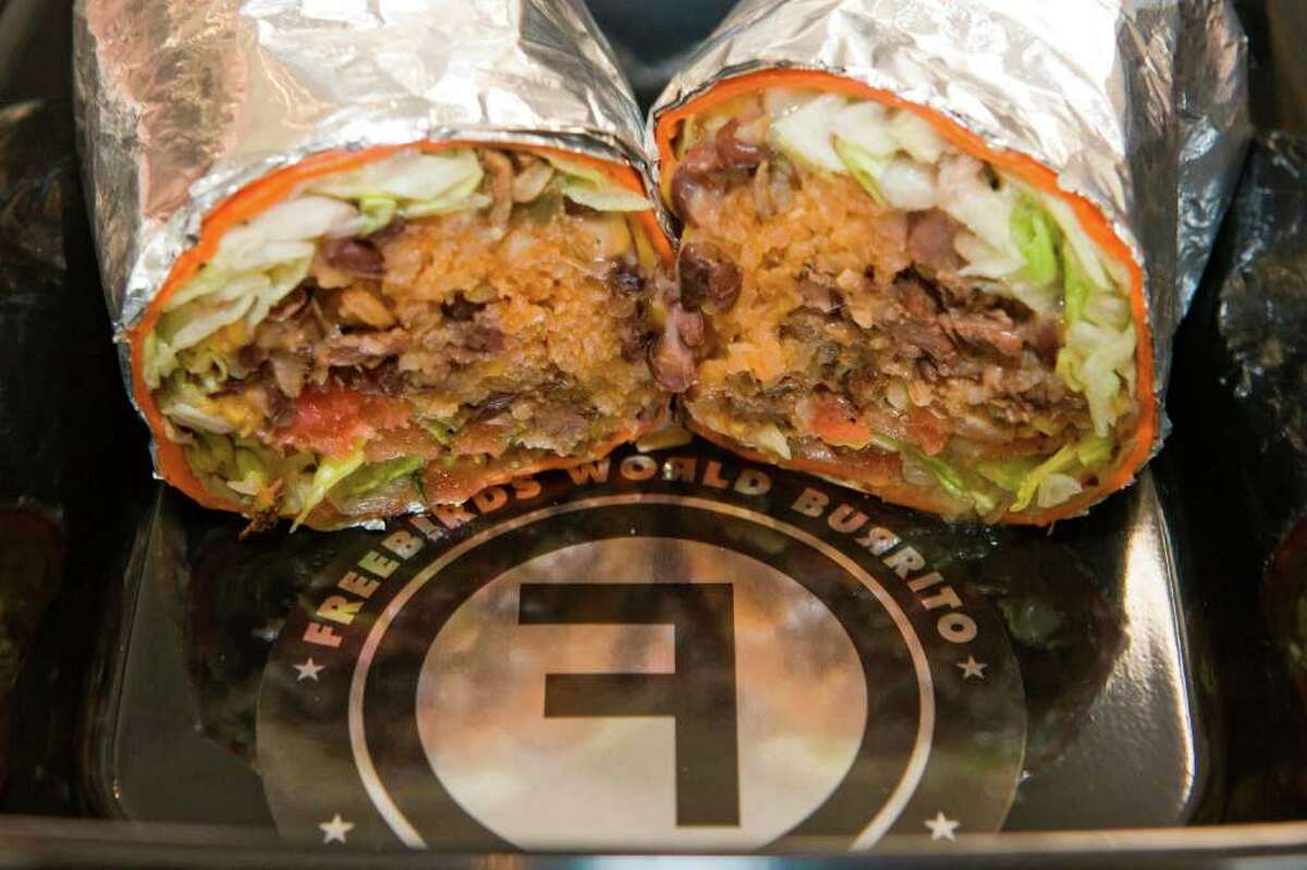 A Steak Burrito from Freebirds World Burrito booth is a popular food item at the Houston Livestock Show and Rodeo. (Friday, March 6, 2009, in Houston. ( Steve Campbell / Houston Chronicle)