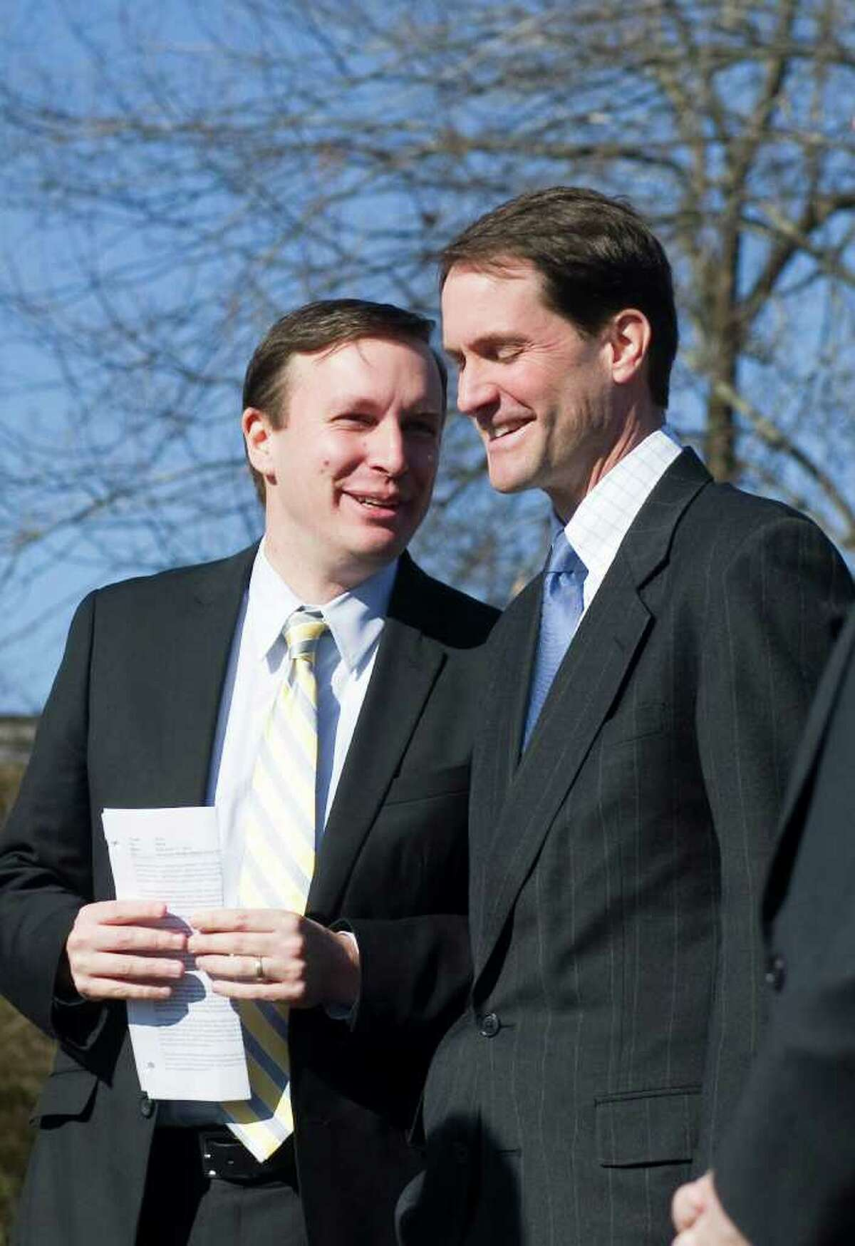 Congressmen Jim Himes and Chris Murphy chat during a press conference in Westport, Conn., February 20, 2012 , to discuss the need to invest in transportation infrastructure. The press conference was held in a commuter lot off of I-95 on Saugatuck Avenue, the highway crosses over the avenue by way of a structurally deficient bridge.