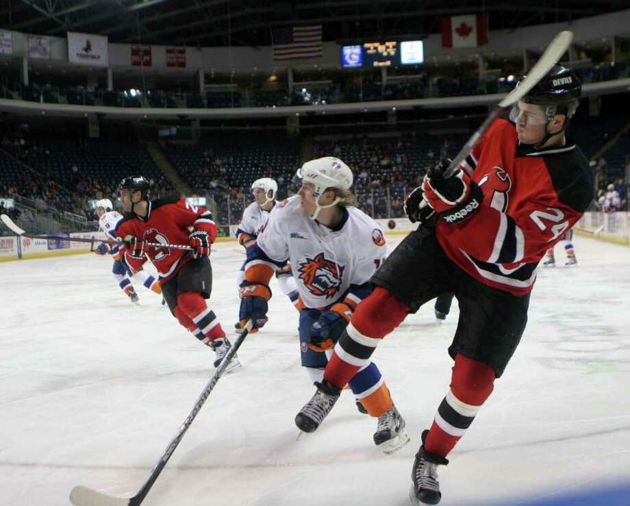 Albany Devil Eric Gelinas, 24, clears the puck during a game against the Bridgeport Sound Tigers at Webster Bank Arena on Monday, February 20, 2012 in Bridgeport, Conn. The Sound Tigers won 3-0. Photo: B.K. Angeletti / Connecticut Post