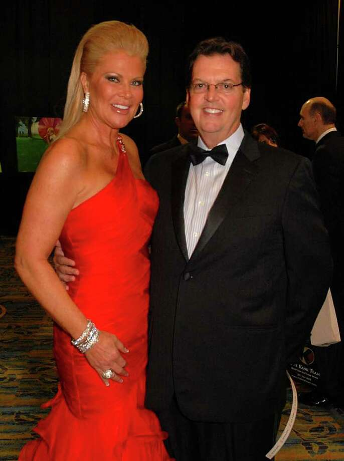 Heart Ball Co-Chairman Theresa Roemer and Richard Lane, both of The Woodlands, visit during the Montgomery County Heart Ball, Paris: An Affair of the Heart, at The Woodlands Waterway Marriott. David Hopper photograph Photo: David Hopper / freelance