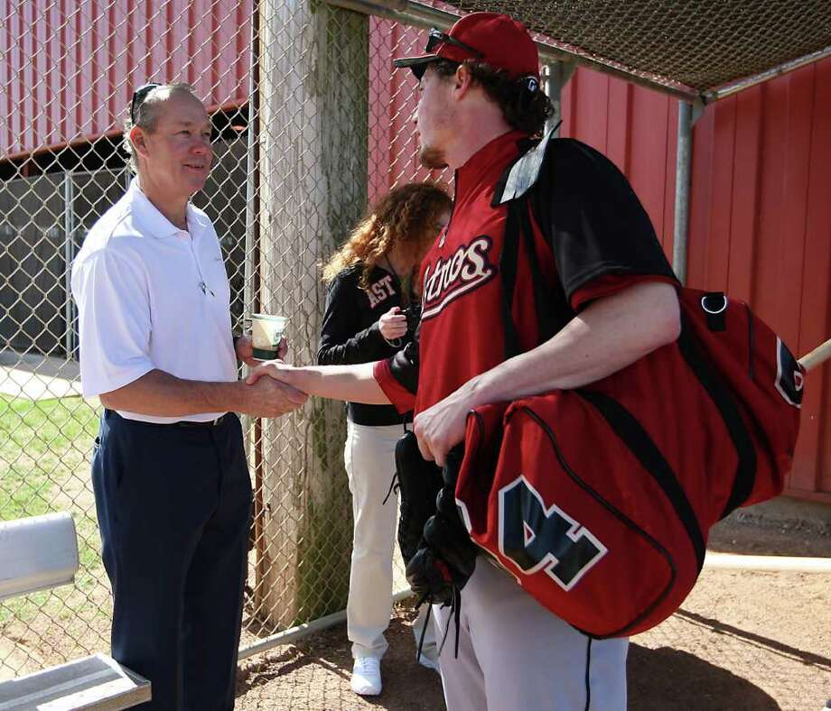 Astros owner and chairman Jim Crane meets Houston Astros RHP Lucas Harrell (64) at Osceola County Stadium on Monday, Feb. 20, 2012, in Kissimmee as they officially began spring training workouts. Photo: Karen Warren, Houston Chronicle / © 2012  Houston Chronicle