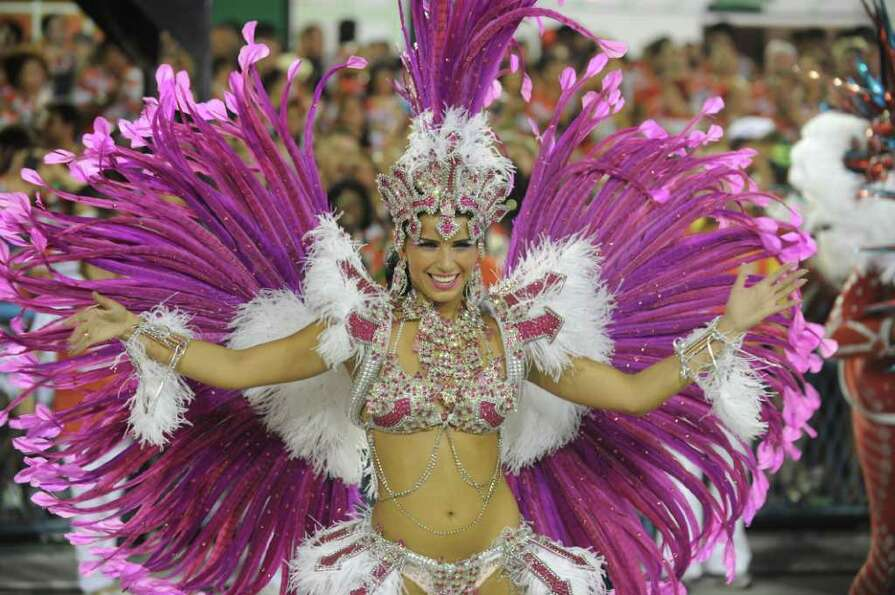 A reveller of Porto da Pedra samba school dances during the first night of carnival parade at the Sa