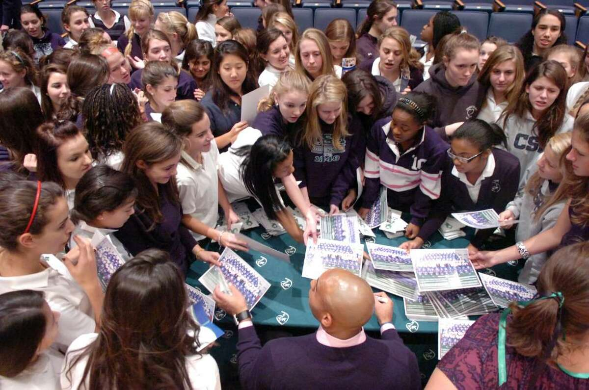 New York Giant Guard Rich Seubert, below center, is swarmed by Sacred Heart students as he signs autographs after addressing the crowd about organ donation at the school Tuesday evening, Nov. 10, 2009. Seubert was part of the