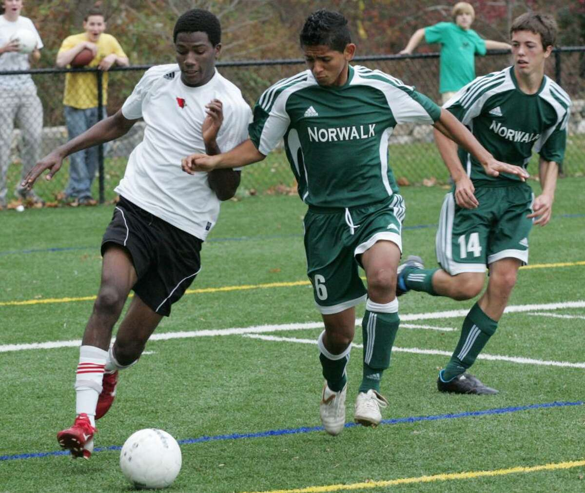 Greenwich High School striker Kenny Doublette makes his way toward the goal as Norwalk defenders Erick Romero and Chris Jeffrey put on the pressure. Mr. Doublette scored the only goal in the Cardinal's win over Norwalk.