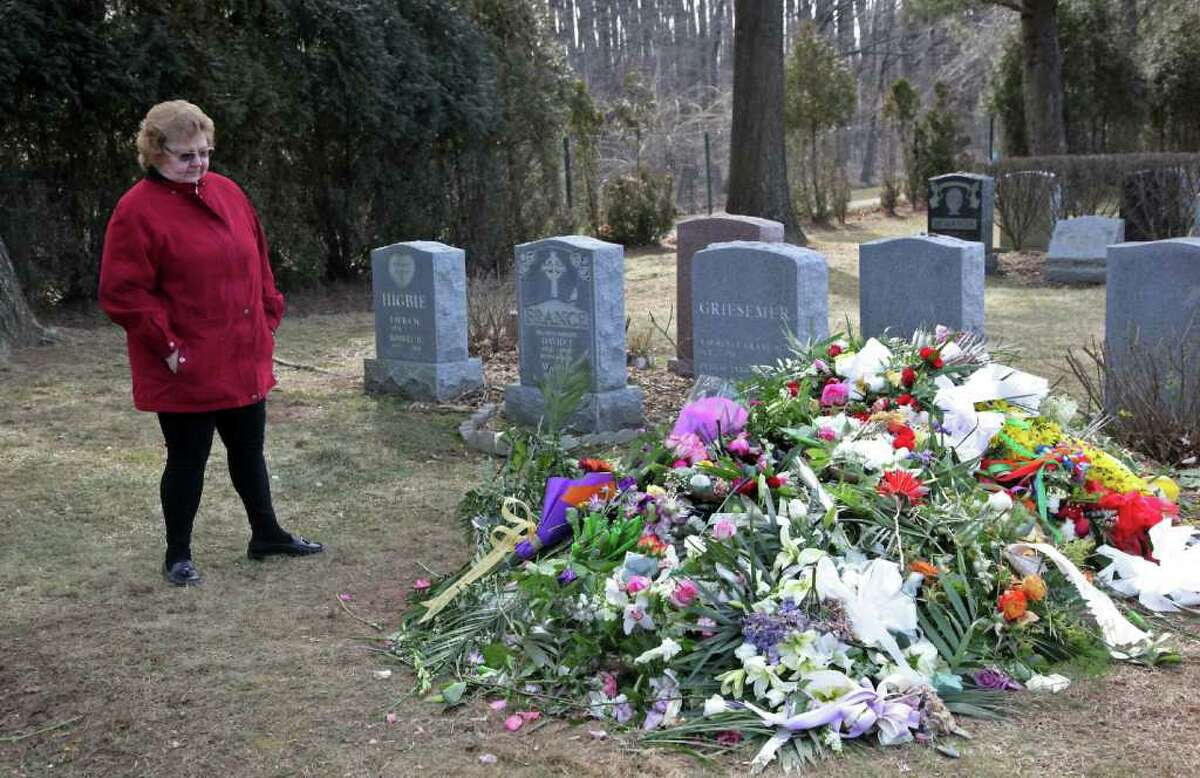 A fan gathers at grave site of singer Whitney Houston located in the East Ridge section of the Fairview Cemetery on February 20, 2012 in Westfield, New Jersey. The singer who was found dead in her hotel room at The Beverly Hilton hotel on February 11, 2012 has been buried close to her father John, who died in 2003.