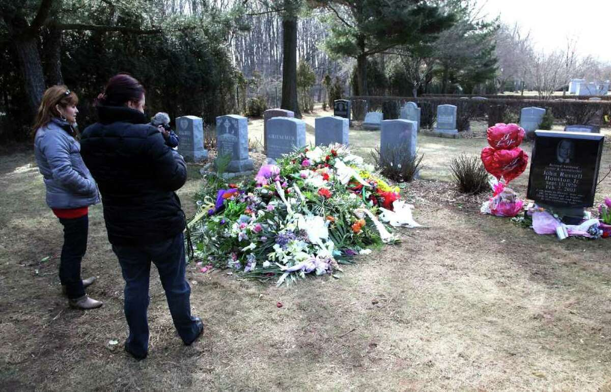 Fans visit the grave site of singer Whitney Houston located in the East Ridge section of the Fairview Cemetery on February 20, 2012 in Westfield, New Jersey. The singer who was found dead in her hotel room at The Beverly Hilton hotel on February 11, 2012 is believed to have been buried close to her father John, who died in 2003.