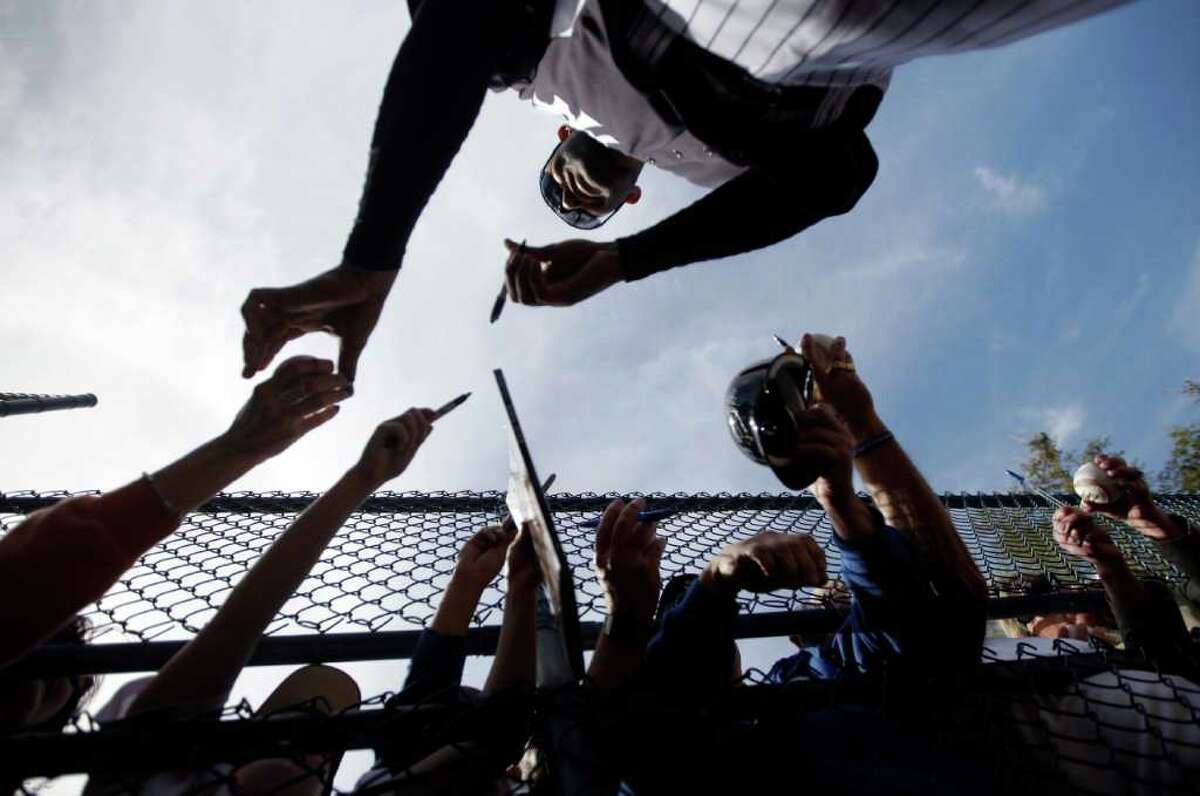 New York Yankees' Mariano Rivera signs autographs after practice at baseball spring training, Monday, Feb. 20, 2012, in Tampa, Fla. (AP Photo/Matt Slocum)