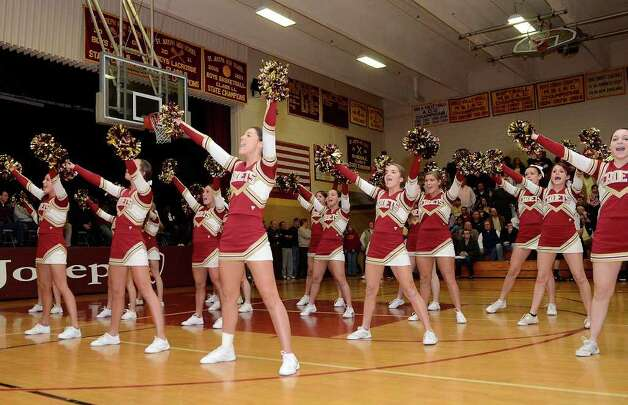 St. Joseph cheerleaders energize the crowd as St. Joseph High School hosts Ridgefield High School in varsity boys basketball in Trumbull, CT on Mon. Feb. 20, 2012. Photo: Shelley Cryan / Shelley Cryan freelance; CT Post freelance
