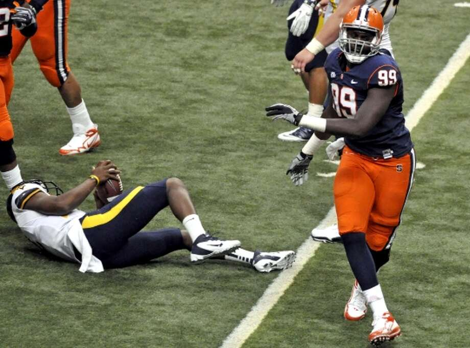 """Chandler Jones, DE,Syracuse - Jones, the brother of UFC champion Jon """"Bones"""" Jones, has a long frame with growth protential.  His body type and style of play makes him a good fit for what Wade Phillips likes to do at weak-side OLB. (Kevin Rivoli / Associated Press)"""