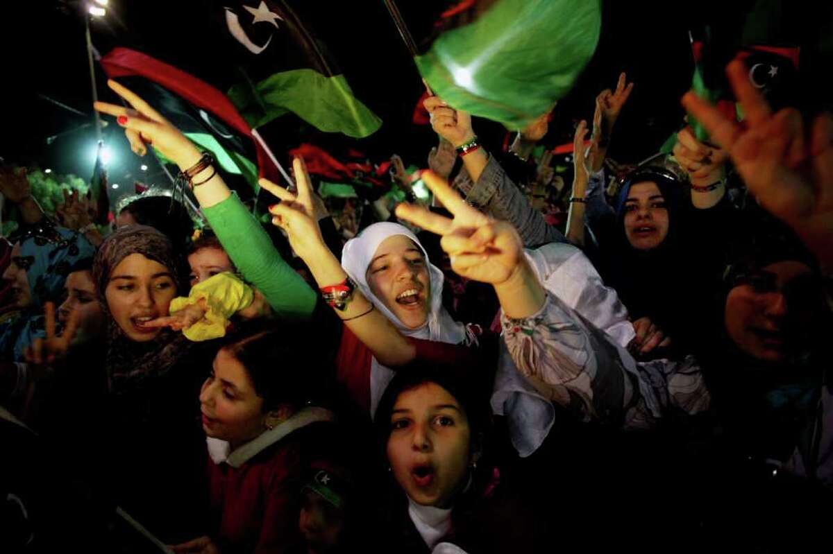 FILE - In this Oct. 23, 2011 file photo, girls and women attend a celebration of Libya's liberation in Freedom Square in Misrata, Libya. The people of Misrata, who played a key role in overthrowing Libyan dictator Moammar Gadhafi, held a vote Monday, Feb. 20, 2012 to elect a new city council. The vote was the first experiment in real democracy anywhere in Libya, and the fact that it happened in Misrata demonstrated the city's newfound clout on the national political scene. (AP Photo/Manu Brabo, File)