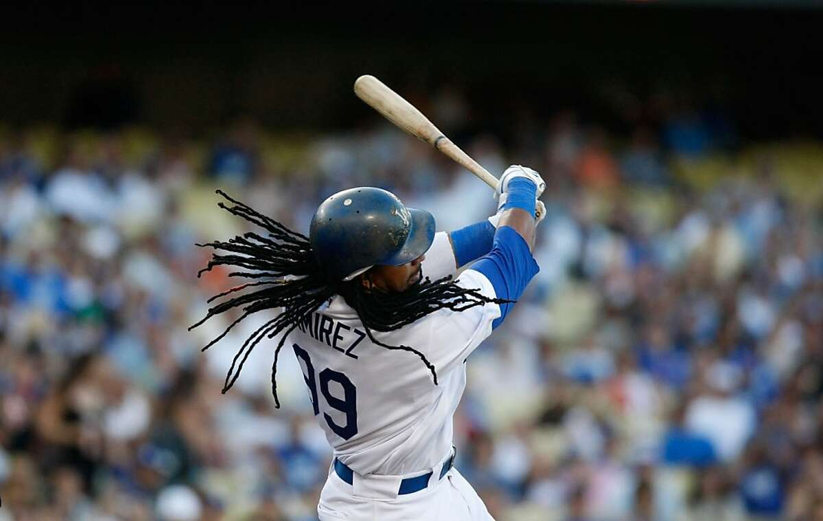 LOS ANGELES, CA - SEPTEMBER 06: Manny Ramirez #99 of the Los Angeles Dodgers swings at a pitch during the game against the San Diego Padres at Dodger Stadium on September 6, 2009 in Los Angeles, California. The Padres defeated the Dodgers 4-3. (Photo by Jeff Gross/Getty Images)