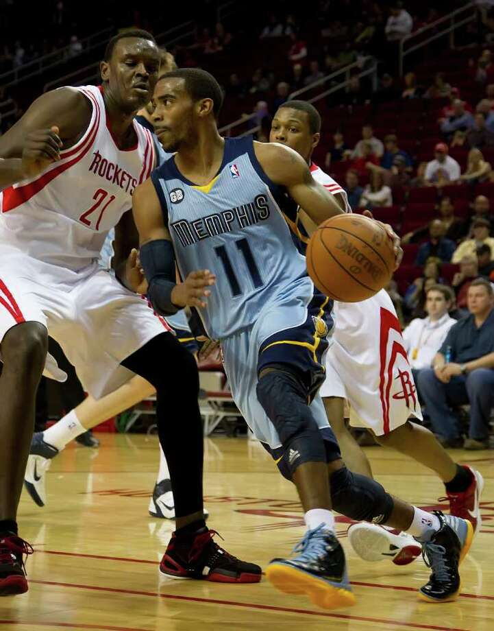 Mike Conley (11) of the Memphis Grizzlies looks to pass as he drives against Samuel Dalembert (21) of the Houston Rockets in the first half on Monday, February 20, 2012, in Houston, Texas. (George Bridges/MCT) Photo: George Bridges, McClatchy-Tribune News Service / MCT